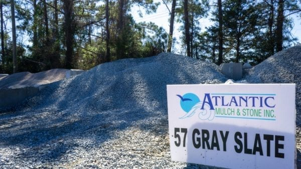 mound of 57 gray slate with sign on right