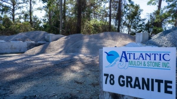 78 granite mound with Atlantic Mulch & Stone sign to the right