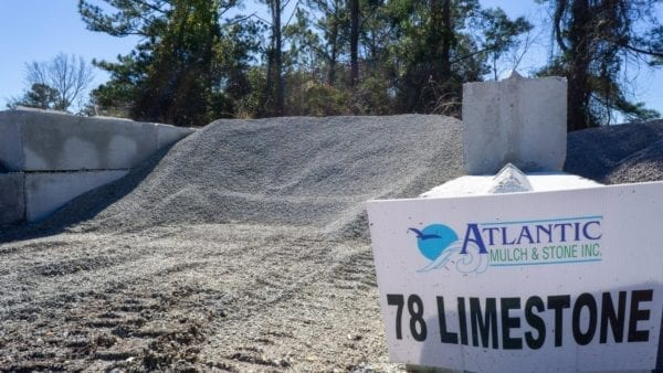 mound of 78 limestone with Atlantic Mulch & Stone sign to the right