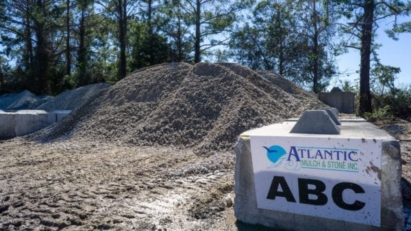 mound of ABC crush & run with Atlantic Mulch & Stone sign to the right
